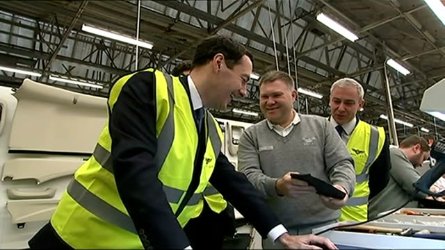 reaction england cheshire crewe bentley motors int george osborne mp being shown how to use heat gun by bentley worker on factory floor worker... - borrowing stock videos & royalty-free footage