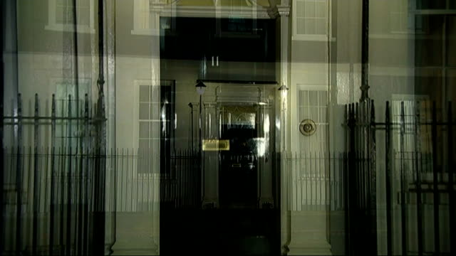 Autumn budget statement preview Downing Street GVs Exterior of Number 11 SPEEDED UP SEQUENCE Flags flying over Downing Street
