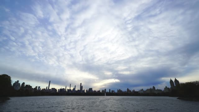 autumn clouds cover the midtown manhattan skyscraper and central park reservoir at evening at central park trees at new york ny usa on nov. 07 2018. - reservoir stock videos and b-roll footage