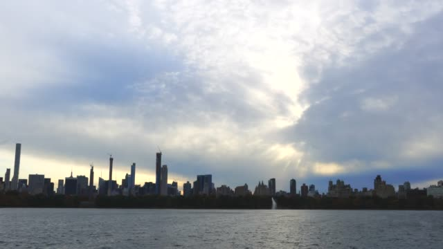 autumn clouds cover the midtown manhattan skyscraper and central park reservoir at evening at central park trees at new york ny usa on nov. 07 2018. - central park reservoir stock videos and b-roll footage