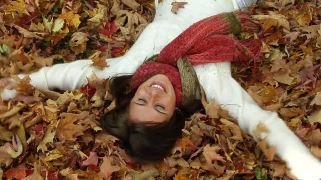 autumn girl - lying on back stock videos and b-roll footage