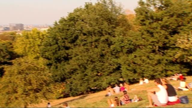 vídeos y material grabado en eventos de stock de greenwich park sunbathers england london greenwich park ext general view people sunbathing in park pan l r / more of sunbathers / woman lying on... - royal navy college