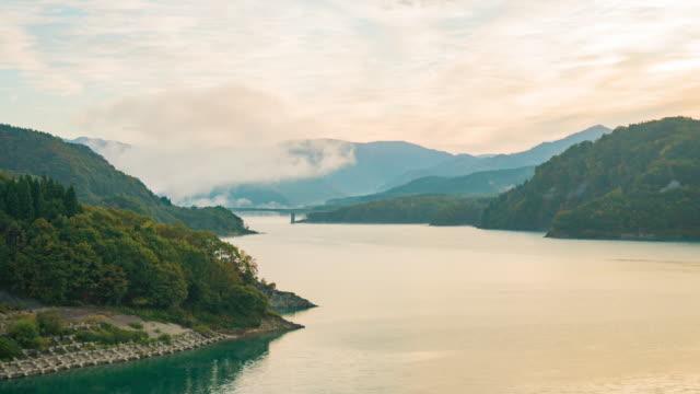 autumn in aomori, bueatiful mountain brigde with colorful forest in moring ,aomori, japan - aomori prefecture stock videos & royalty-free footage
