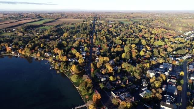 stockvideo's en b-roll-footage met autumn morning aerial of main street - straatnaambord