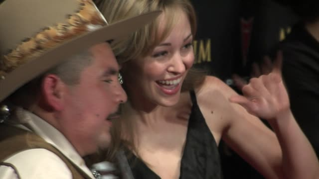 autumn resser and cowboy at the 2006 maxim hot 100 party at buddha bar in new york, new york on may 18, 2006. - ブッダバー点の映像素材/bロール