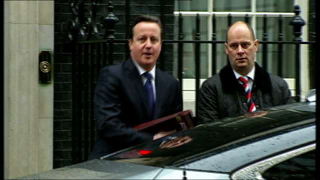 autumn statement 2012; downing street: prime minister david cameron from number 10 to car as asked if we are facing more austerity by reporter sot - prime minister stock videos & royalty-free footage