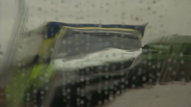 NHS and social care EXT Rain on window as ambulance reflected in surface Monica Byrne interview SOT want mum to go to home where I can see her...