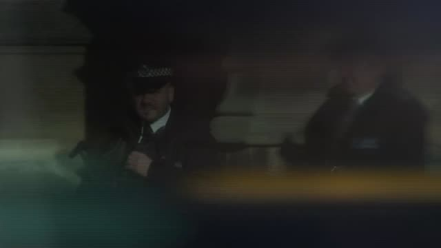 police cuts / nhs spending england london ext three police officers patrolling in central london armed police patrol outside houses of parliament... - gun belt stock videos and b-roll footage