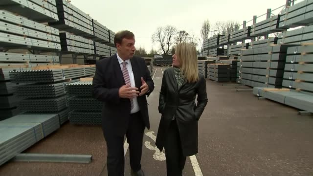 reaction EXT Wide shot steelworks Stewart Towe interview as along with reporter SOT Traffic along Woman along to cash machine Various shots people...