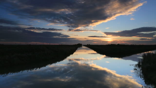 autumn sunset on the 20 foot drain, whittlesey town. - fen stock videos and b-roll footage