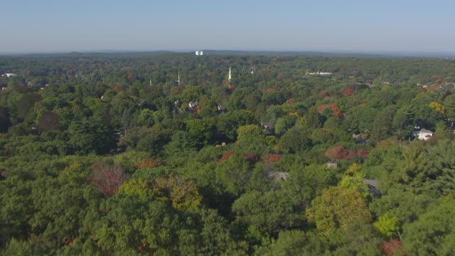 ws aerial pov autumn tree green area at town / lexington, massachusetts, united states - lexington massachusetts stock videos & royalty-free footage