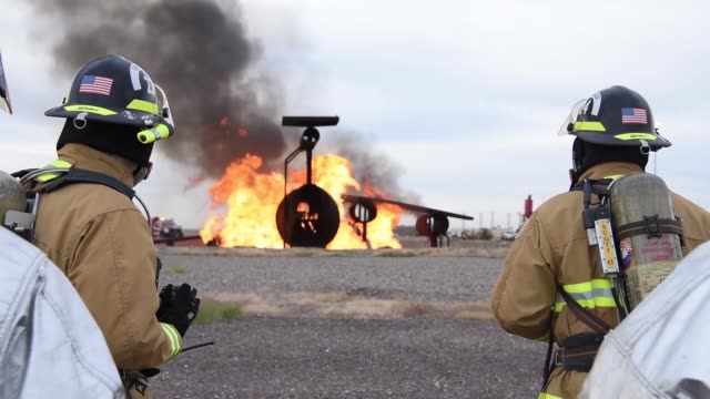Auxiliary Field firefighters joined forces with US Fire Service to train for aircraft and structural live fires