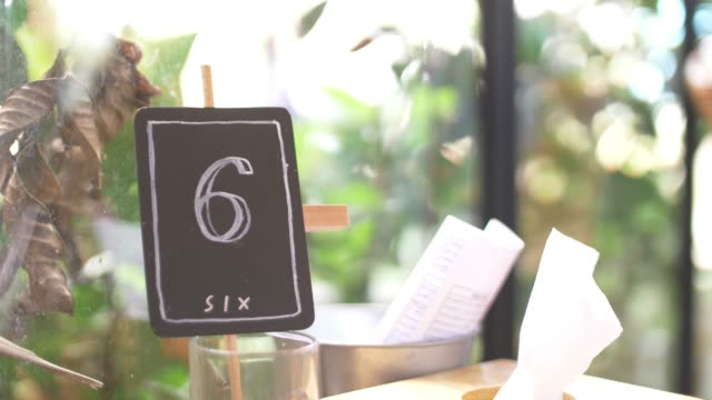 available table in coffee cafe - number 6 stock videos & royalty-free footage