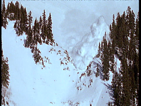 avalanche flow descends down mountain side and engulfs camera, the rockies - sliding stock videos & royalty-free footage