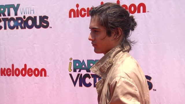 avan jogia at the nickelodeon's 'iparty with victorious' premiere at west hollywood ca. - nickelodeon stock videos & royalty-free footage