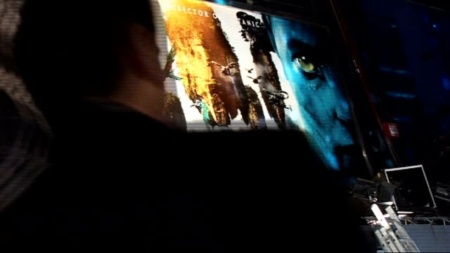 'avatar' film premiere in london's leicester square: interviews on the 'blue carpet'; england: london: leicester square: ext / night 'avatar' posters... - giovanni ribisi stock videos & royalty-free footage