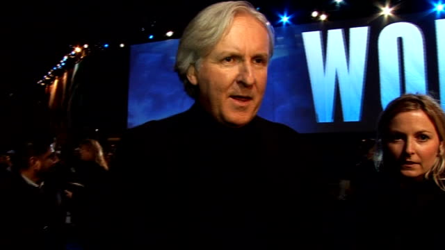 'avatar' film premiere in london's leicester square: interviews on the 'blue carpet'; general view james cameron being interviewed / james cameron... - epic film stock videos & royalty-free footage