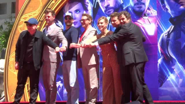 stockvideo's en b-roll-footage met avengers endgame cast place their handprints in cement outside tcl chinese theatre in hollywood in celebrity sightings in los angeles - ensemble lid