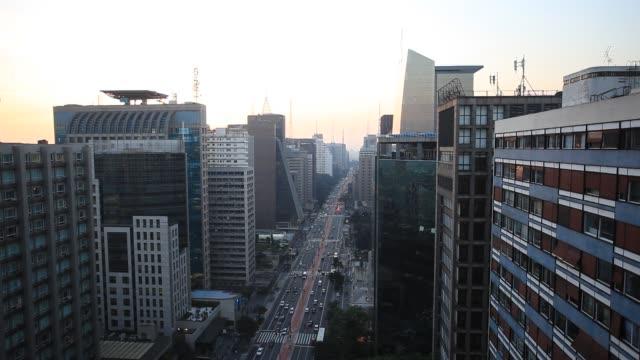 avenida paulista in central sao paulo at dusk - avenida stock videos & royalty-free footage