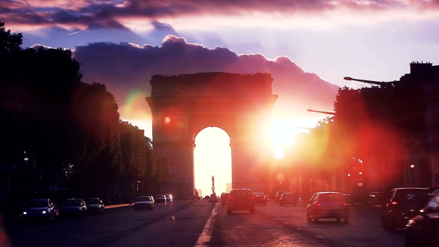 avenue des champs-elysees with arch of triumph during sunset - french culture stock videos & royalty-free footage