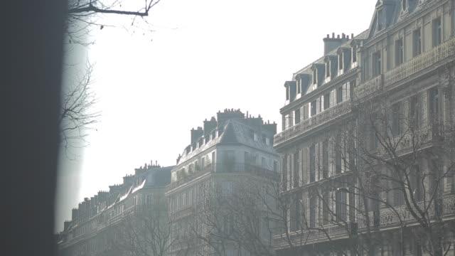 Avenue in Paris, France. Typical residential buildings near avenue des Champs Elysées. Street in Paris.