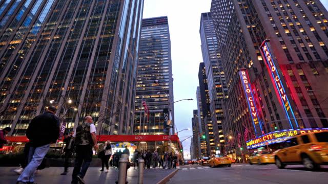 6 avenue new york. street. yellow taxi, pedestrian. radio city hall. - the media stock videos & royalty-free footage