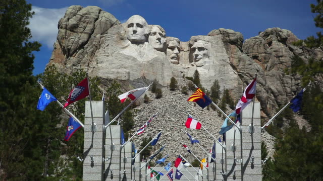 ws avenue of flags at mount rushmore national memorial, custer state park / south dakota, usa - mt rushmore national monument stock videos and b-roll footage