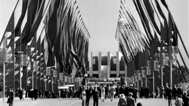 Avenue of Flags at the Century of Progress World's Fair / US Postmaster General James Farley formally opens the fair / Farley at podium / midway...