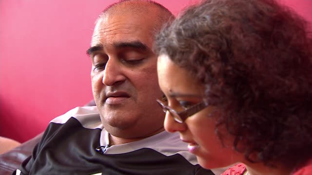 Average age of stroke victims falls because of lifestyle choices ENGLAND INT Various of stroke victim Reza CurreemKalee sat on sofa with his wife...
