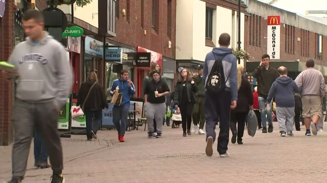 Average earnings continue to grow below inflation EXT Crowds along past shops