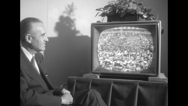 averell harriman seated watching democratic convention on tv, boy next to him probably family member; boy points to screen seeing themselves,... - television show stock videos & royalty-free footage