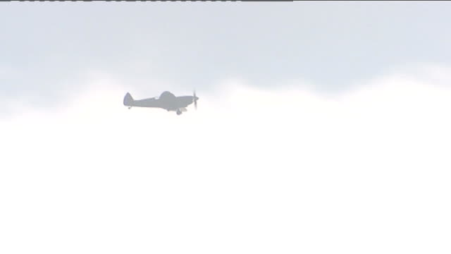 75th anniversary of spitfire maiden flight preparations restored spitfire aircraft fluing overhead carolyn grace interview sot - anmut stock-videos und b-roll-filmmaterial