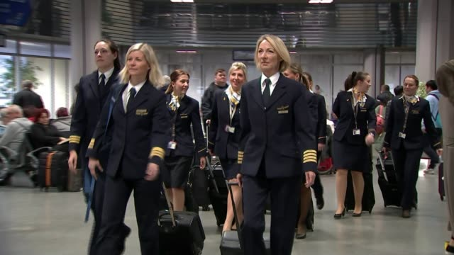airline industry aims to recruit more women pilots; england: int women pilots along with suitcases int plane pilots towards into plane woman in... - pilot stock videos & royalty-free footage