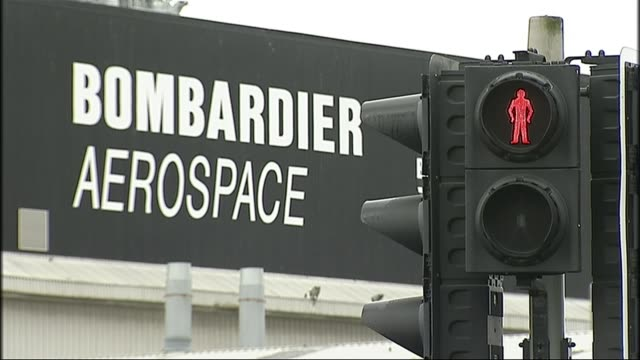 Bombardier wins in dispute with Boeing LIB / TX IRELAND Belfast EXT Red man on pedestrian crossing light with 'Bombardier Aerospace' sign in...