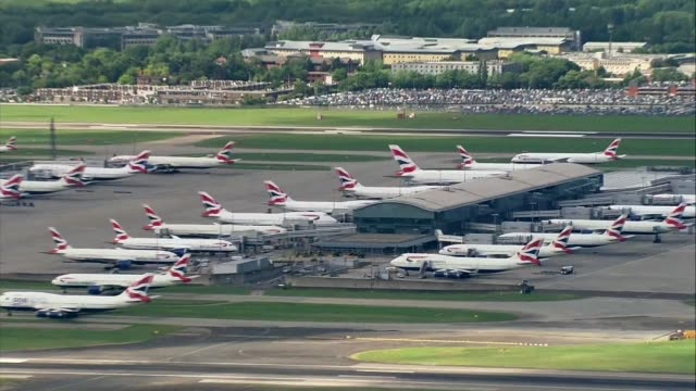 british airways computer failure causes flight cancellations england london heathrow airport large number of british airways aircraft parked at gates... - taxiway stock videos & royalty-free footage