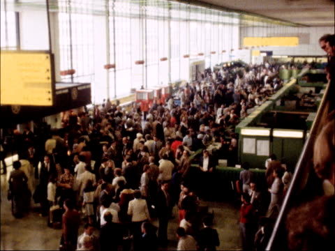 delays at airports caused by strike action by air traffic controllers england crowds in airport departure lounge tx'd 230679 / 115 pm - strike industrial action stock videos & royalty-free footage