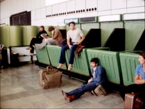 delays at airports caused by strike action by air traffic controllers england london mass passengers in departure lounge ms inside terminal 2 pan... - 1979 stock videos and b-roll footage