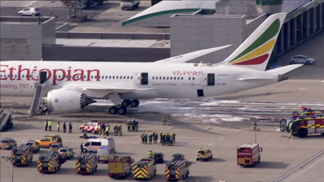 fire on board ethiopian airlines boeing 787 dreamliner aircraft at heathrow airport air views / aerials ethiopian airlines boeing 787 dreamliner... - boeing 787 stock videos and b-roll footage