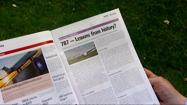 fire on board ethiopian airlines boeing 787 dreamliner aircraft at heathrow airport england howard wheeldon setup reading magazine articel about 787... - äthiopien stock-videos und b-roll-filmmaterial