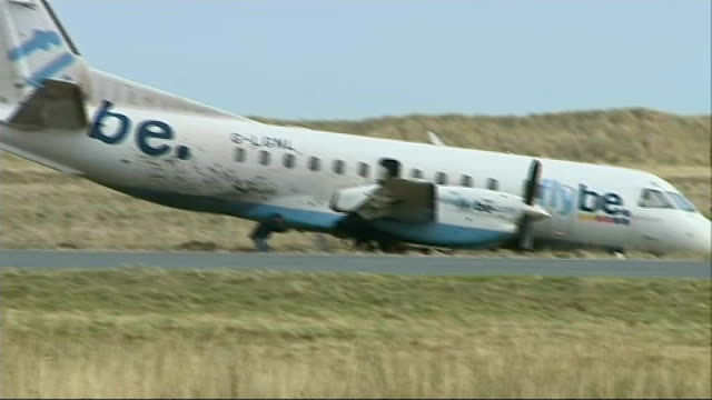 Four passengers injured in Stornoway Airport crash SCOTLAND Outer Hebrides Stornway Airport EXT Various shots of crashed Loganair Saab 340 aircraft...