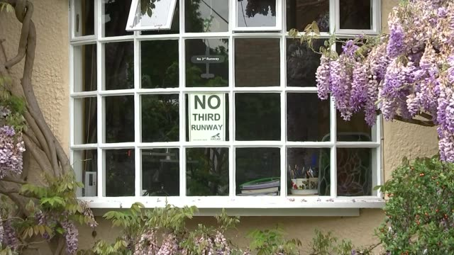 heathrow airport offers to ban night flights in bid to secure third runway; london: harmondsworth: house in village house in village sign 'no third... - christine taylor stock videos & royalty-free footage
