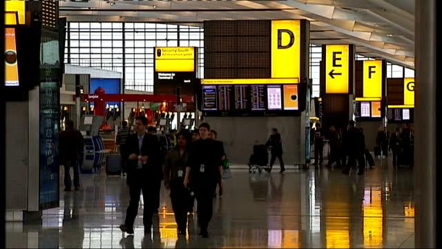 Heathrow Airport Terminal 5 problems continue ENGLAND London Heathrow Airport Terminal 5 INT Passengers along in Terminal 5 / passenger at checkin...