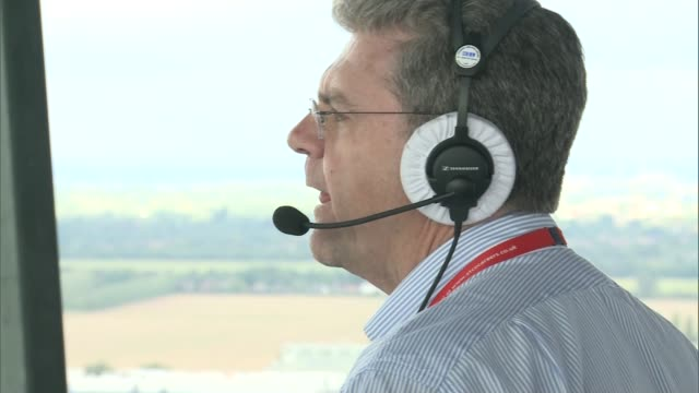 heathrow's air traffic controllers rely on hightech weather forecasts int air traffic controller speaking on headset lapse footage of air traffic... - air traffic control stock videos & royalty-free footage
