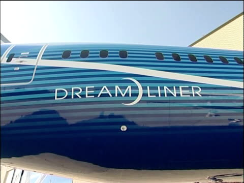 launch of boeing 787 dreamliner people applauding and cheering as the dreamliner aircraft is revealed / various of people walking around and looking... - boeing 787 stock videos and b-roll footage