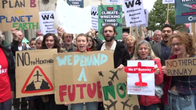 Legal action against Heathrow third runway begins ENGLAND London Royal Courts of Justice EXT Protesters outside court Nick Ferriday interview SOT