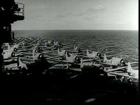 stockvideo's en b-roll-footage met machinists' mate cu aviation machinists' mate rating badge ha ws single engine fighter airplanes lined up on aircraft carrier deck at sea ms mate... - 1942