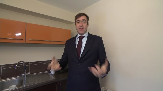 stockvideo's en b-roll-footage met man transforms dining room into boeing 737 cockpit simulator england south yorkshire barnsley int reporter to camera around kitchen to boeing 737... - dining room