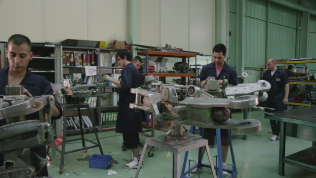 ds ws aviation mechanic trainees at work on aircraft components  in the workshop of a training facility, red r3d 4k - trainee stock videos & royalty-free footage
