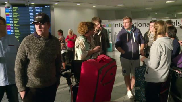 Monarch Airlines folds overnight leaving thousands stranded ENGLAND West Sussex Gatwick Airport INT People in airport terminal Woman crying People...