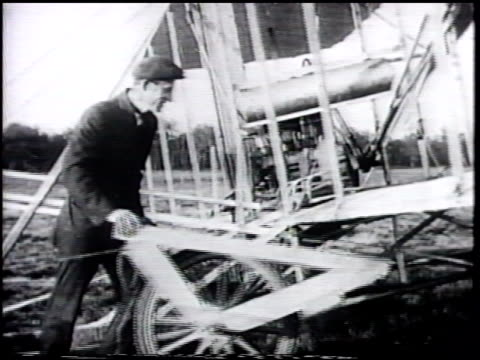 Aviation pioneer Wilbur Wright w/ unidentifed men ZI Wilbur LE MANS FRANCE VS Wilbur amp men preparing aircraft mounting on catapult turning...
